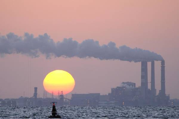 Photograph - Coal Power Plant And Sun by Bradford Martin