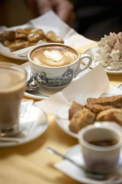 Coffee Drinks And Biscotti On Table In Cafe (focus On Cappuccino) Art Print by Bob Handelman