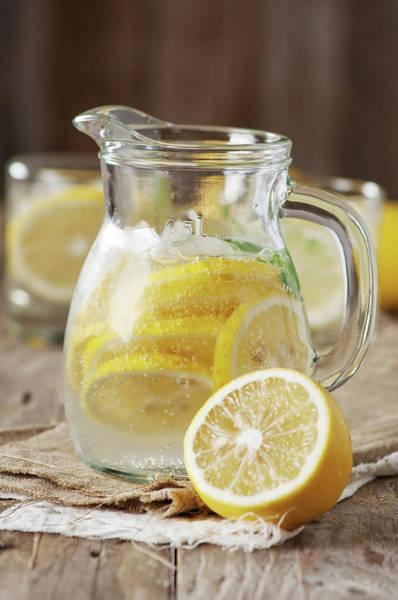 Lemon Photograph - Cold Lemon Water by Oxana Denezhkina