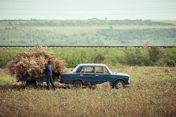 Casual Photograph - Collecting Corn With A Lada, Moldova by Jean-philippe Tournut