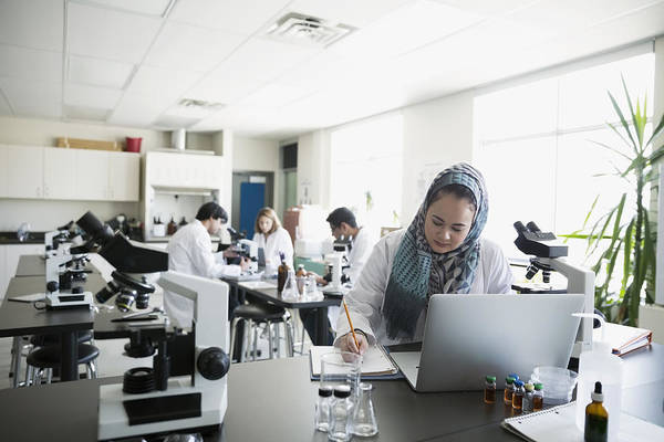 College Student Wearing Hijab At Laptop In Science Laboratory Art Print by Hero Images