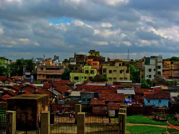 Kolkata Photograph - Colorful Buildings With Monsoon Clouds by Amlan Mathur