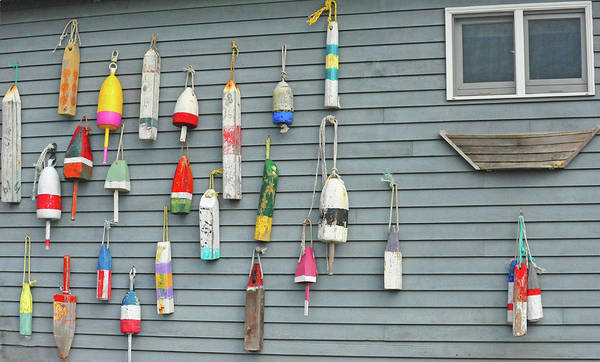 Hanging Photograph - Colorful Buoys Hanging On Side Of House by Heather Paul