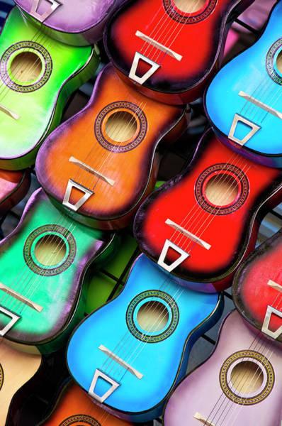 Texas A Photograph - Colorful Guitars by Gabriel Perez