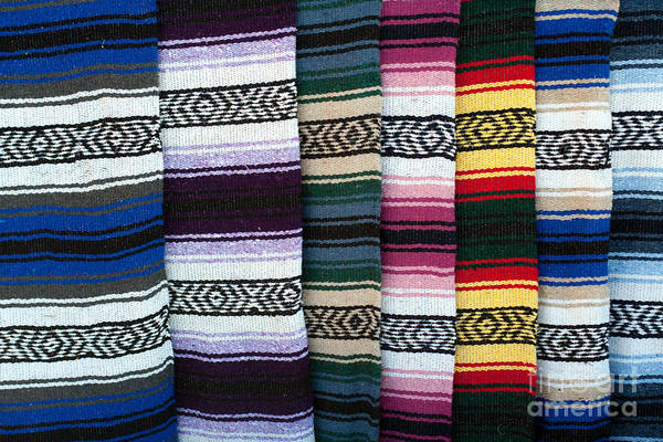 Photograph - Colorful Indian Rug Display by Gunter Nezhoda
