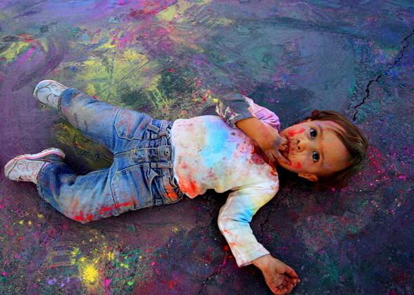 Photograph - Colorful Kid. Indian Celebration Of Holi by John King
