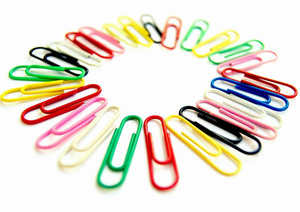 Colorful Office Clips Arranged In A Circle In A White Background Art Print by Blanchi Costela