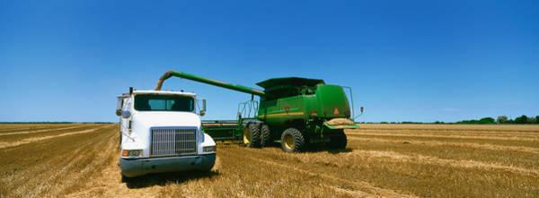 Nebraska Landscape Photograph - Combine In A Wheat Field, Kearney by Panoramic Images
