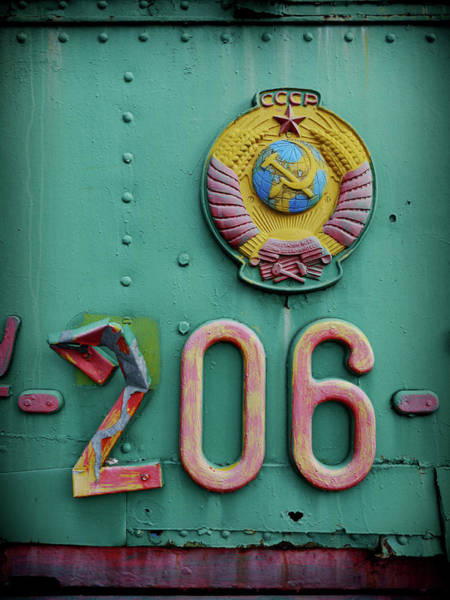 Moldova Wall Art - Photograph - Communist Badge On A Train by Amos Chapple