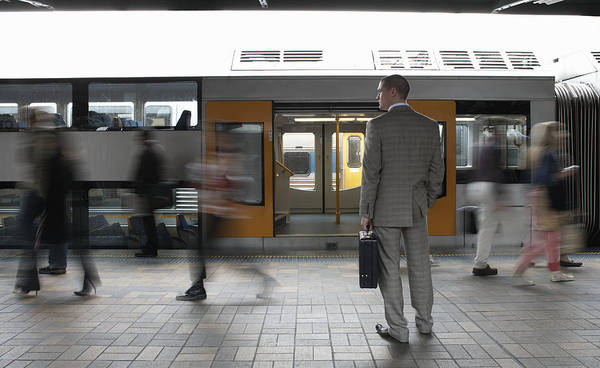 Commuters Passing Businessman On Platform,  (blurred Motion) Art Print by Toby Burrows