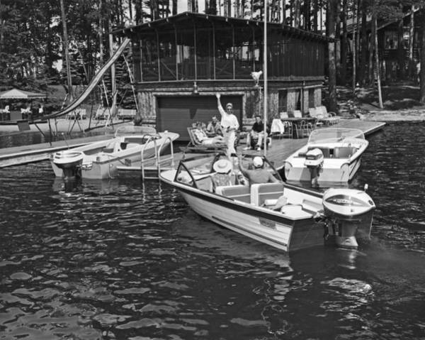 Outboard Photograph - Company Arrives At The Cabin By Boat by Underwood Archives