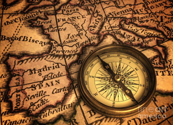 Direction Photograph - Compass And Ancient Map Of Europe by Colin and Linda McKie