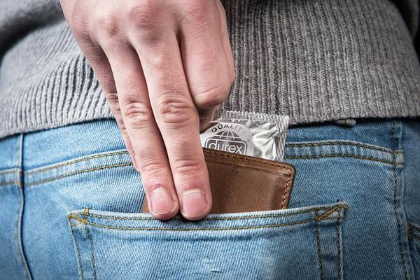 Wall Art - Photograph - Condom In Back Pocket by Cedric Hatto/reporters/science Photo Library
