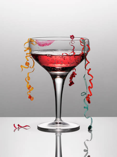 Excess Photograph - Confetti Hanging From Glass Of Pink by Andy Roberts