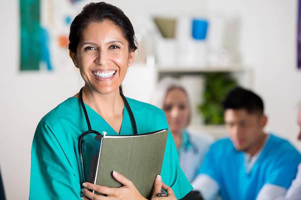 Confident Doctor In Medical Staff Meeting Art Print by Steve Debenport