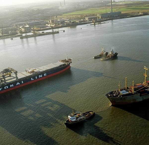 Tug Boat Photograph - Container Ship Being Towed By Tug Boats by Skyscan/science Photo Library