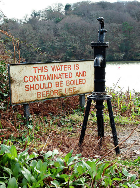 Public Health Photograph - Contaminated Water Sign Next To Public Water Hand Pump by Education Images/uig/science Photo Library