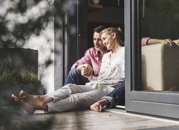 Content Mature Couple Relaxing Together At Open Terrace Door Art Print by Westend61