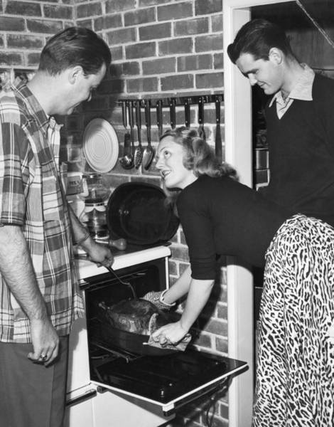 Checking Photograph - Cooking A Thanksgiving Turkey by Underwood Archives