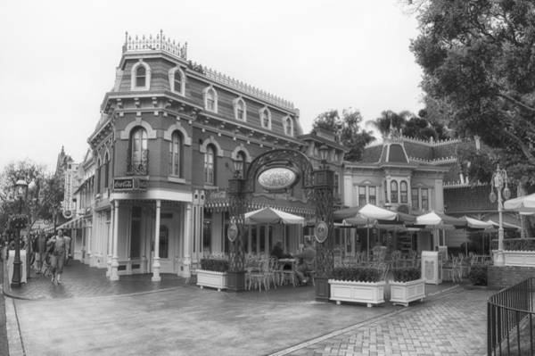 Wall Art - Photograph - Corner Cafe Main Street Disneyland Bw by Thomas Woolworth
