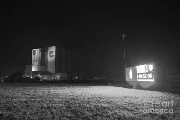 Delta Iv Photograph - Countdown Clock At Night, Kennedy Space by Chris Cook
