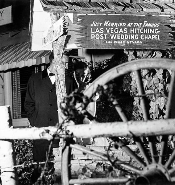 Wheel Photograph - Couple At Las Vegas Hitching Post Wedding Chapel by Richard Waite