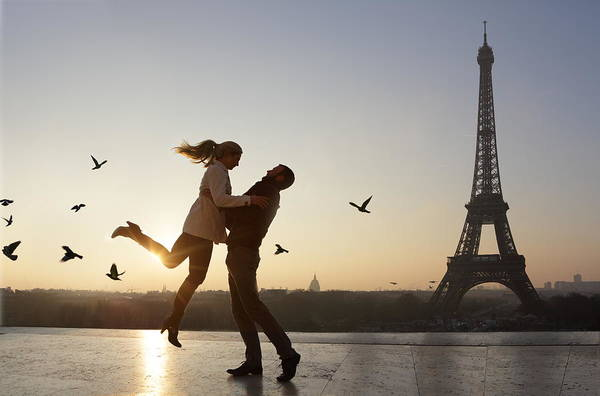 Couple Embracing, View Of Eiffel Tower Art Print by Peter Cade
