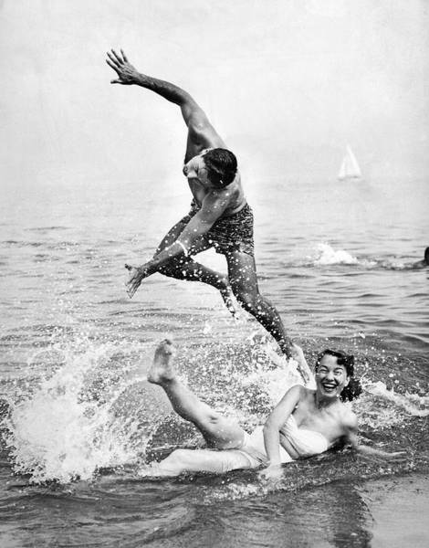 Caucasian Wall Art - Photograph - Couple Frolics In The Surf by Underwood Archives