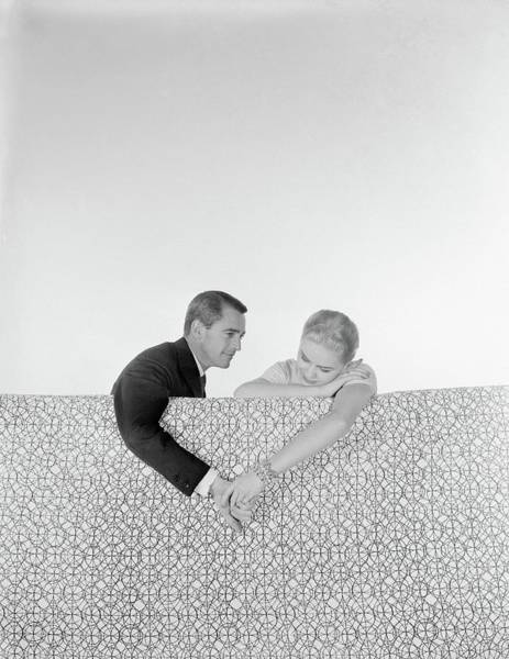 Love Photograph - Couple Holding Hands On Sofa by Horst P. Horst