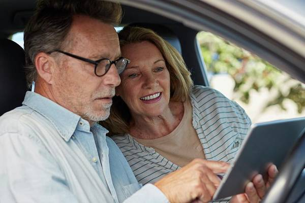 Senior Photograph - Couple In Car With A Digital Tablet by Science Photo Library