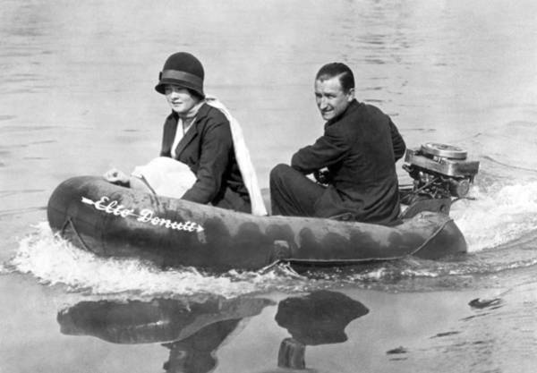 Outboard Photograph - Couple Out In A Rubber Raft by Underwood Archives