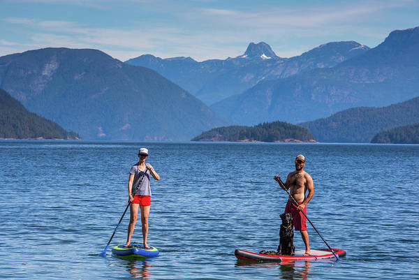 Standup Paddleboard Photograph - Couple Paddleboarding In Desolation by Michael Hanson
