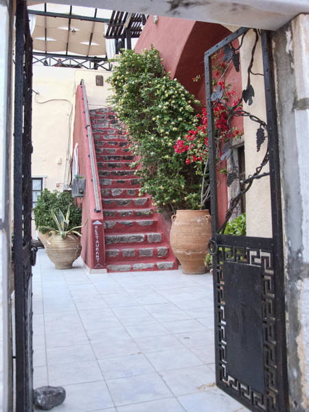 Taverna Photograph - Courtyard Stairway by Phyllis Taylor