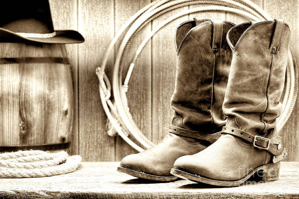 Rodeo Photograph - Cowboy Boots Outside Saloon by Olivier Le Queinec