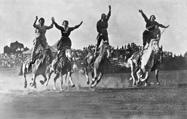Raising Wall Art - Photograph - Cowgirls At The Rodeo by Underwood Archives