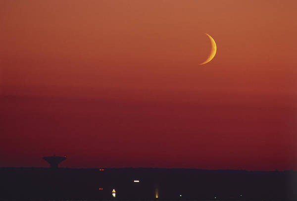 Satellite Dish Photograph - Crescent Moon Over A Satellite Dish by Pekka Parviainen/science Photo Library