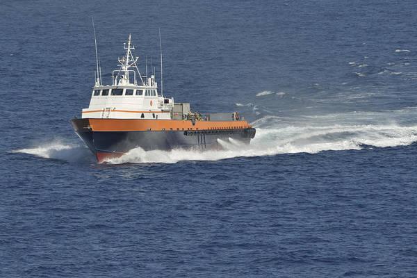 Photograph - Crew Boat In Blue Ocean by Bradford Martin