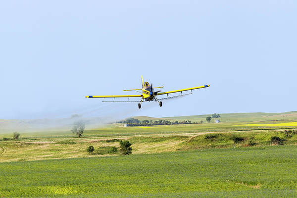 North Dakota Photograph - Crop Duster Airplane Spraying Flax by Chuck Haney