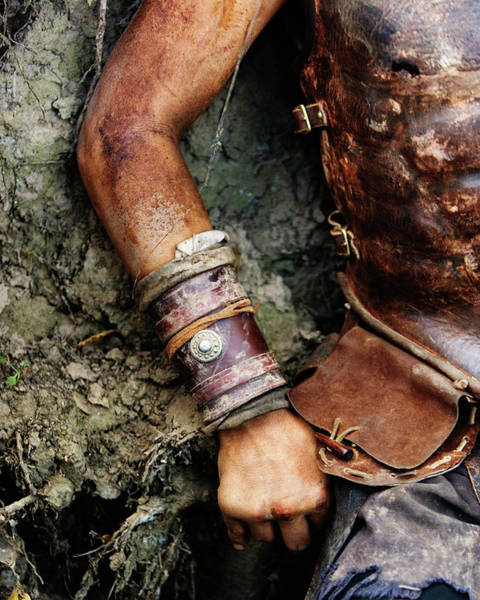 Wall Art - Photograph - Cropped Arm And Torso In Leather Armor by Ron Koeberer