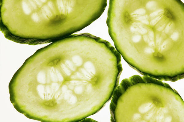 Cucurbit Photograph - Cucumber Slices, Backlit by Foodcollection