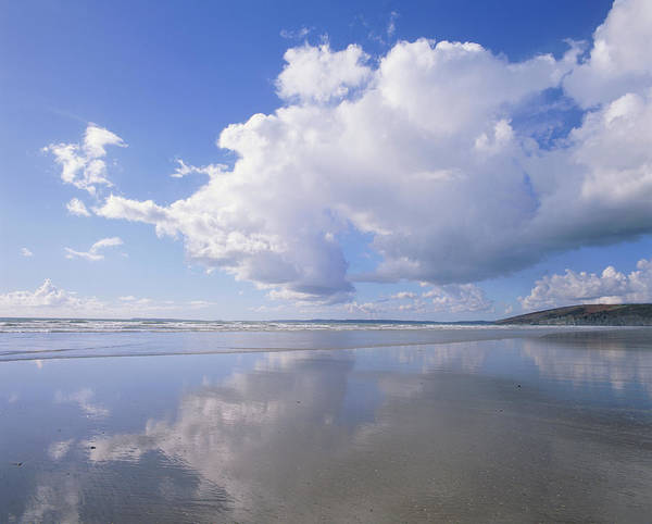 Cumulus Photograph - Cumulus Clouds Reflected On Water by Simon Fraser/science Photo Library