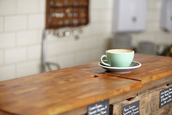 Bar Counter Photograph - Cup Of Coffee In A Mint Green Mug by Ezra Bailey