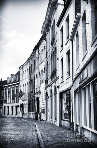 Wall Art - Photograph - Curved In Bruges by John Rizzuto