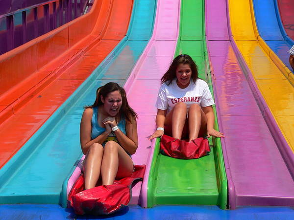 Photograph - Cute Girls On Slide Ride by Jeff Lowe