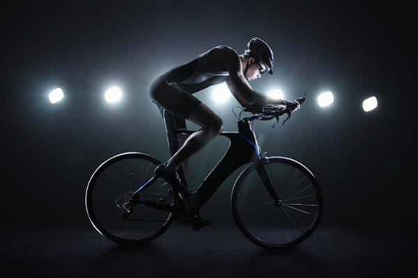Headwear Photograph - Cyclist Riding At Night In The City by Stanislaw Pytel