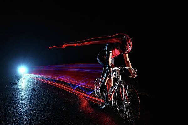 End Of The Trail Photograph - Cyclist Riding At Night Leaving Streaks by Stanislaw Pytel