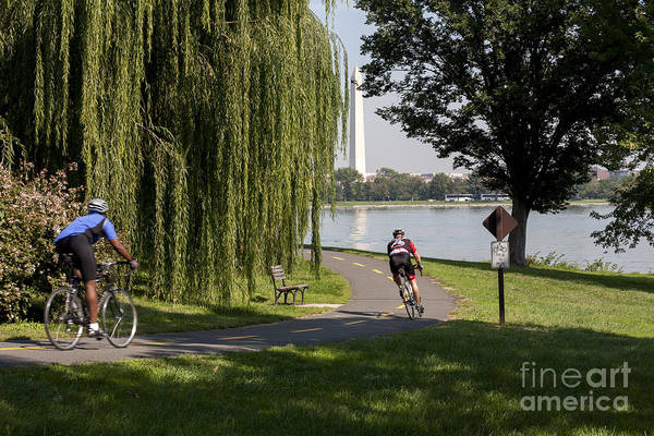 Wall Art - Photograph - Cyclists On Bike Path With Washington Monument In Background Across The Potomac by William Kuta