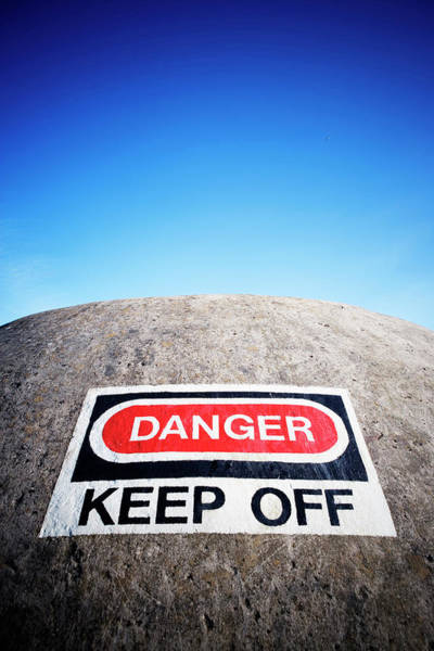 Low Battery Photograph - Danger Sign On A Buried Concrete by Ron Koeberer