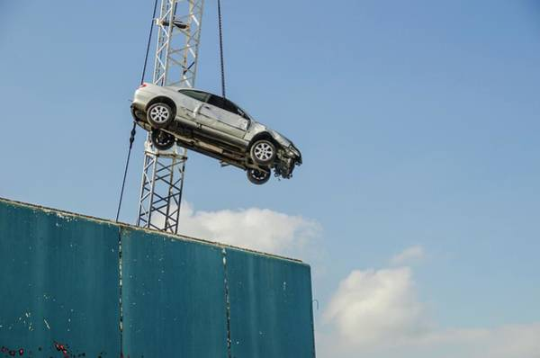 Suspended Photograph - Dangling Car by Robert Brook