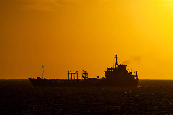 Montevideo Photograph - Dark Boat Silhouette At Sunset by Jess Kraft